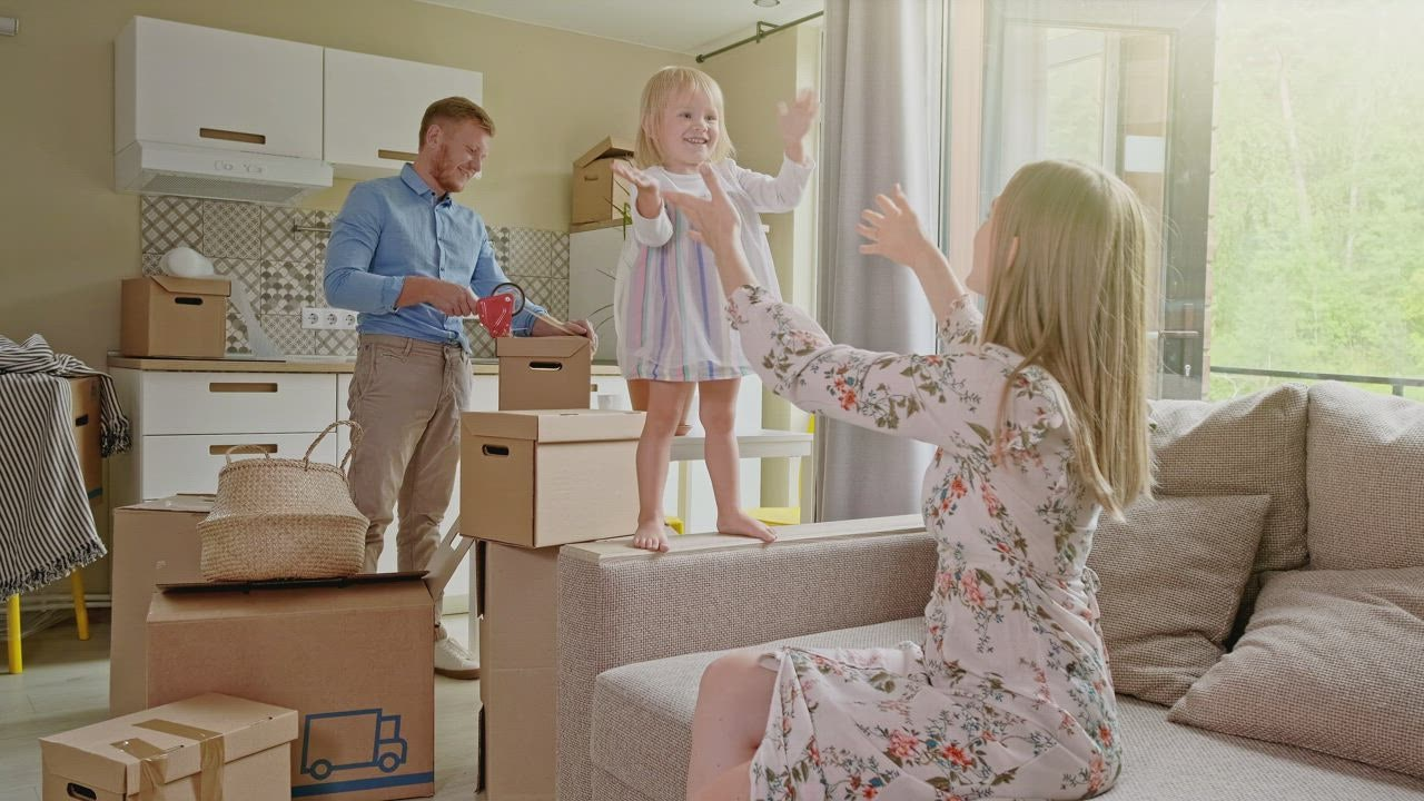 mixkit-happy-family-packing-to-move-37049-0